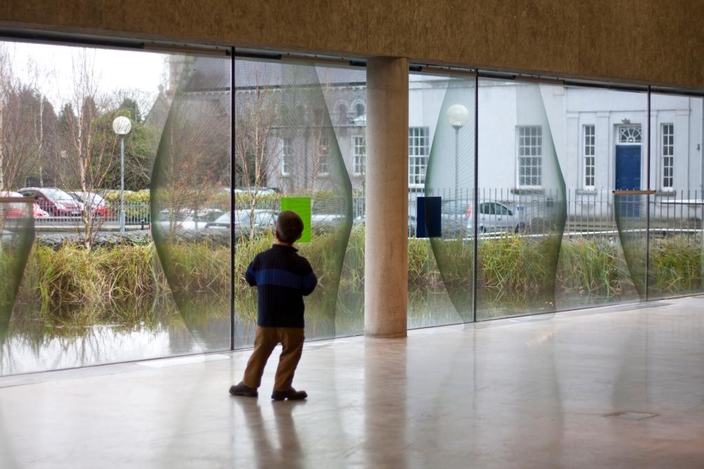 Corban Walker in front of installation